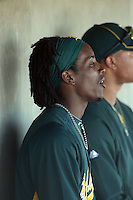 Jemile Weeks #59 of the Oakland Athletics watches his teammates against the Cleveland Indians in a spring training game at Phoenix Municipal Stadium on March 2, 2011  in Phoenix, Arizona. .Photo by:  Bill Mitchell/Four Seam Images.