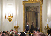 United States President Barack Obama and US Vice President Joe Biden are seen reflected in a mirror as Obama delivers remarks at the Easter Prayer Breakfast at the White House in Washington, D.C. on March 30, 2016. <br /> Credit: Kevin Dietsch / Pool via CNP