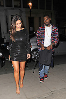 NON EXCLUSIVE PICTURE: MATRIXPICTURES.CO.UK.PLEASE CREDIT ALL USES..WORLD RIGHTS..American hip hop rapper Kanye West and his girlfriend, reality TV star Kim Kardashian, are pictured leaving Hakkasan restaurant in London's Mayfair...The loved-up couple then head to a recording studio...NOVEMBER 8th 2012..REF: LTN 125159