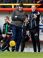 7th March 2020; Pittodrie Stadium, Aberdeen, Scotland; Scottish Premiership Football, Aberdeen versus Hibernian; Jack Ross Hibernian Manager plays with the game ball in the dug out