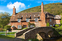 Famous traditional Drovers Bridge or Packhorse Packet Bridge at Allerford on Exmoor, Somerset, United Kingdom