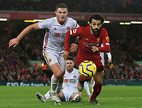 2nd January 2020; Anfield, Liverpool, Merseyside, England; English Premier League Football, Liverpool versus Sheffield United; Mohammed Salah of Liverpool  races after the ball inside the Sheffield United penalty area - Strictly Editorial Use Only. No use with unauthorized audio, video, data, fixture lists, club/league logos or 'live' services. Online in-match use limited to 120 images, no video emulation. No use in betting, games or single club/league/player publications