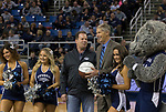 Dr. James Lynch is given a autographed basketball by Nevada Athletics Director Doug Knuth during a time out in an NCAA college basketball game against San Jose State in Reno, Nev., Wednesday, Jan. 9, 2019. (AP Photo/Tom R. Smedes)