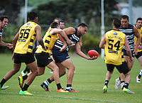 Action from the Wellington Australian Rules Football National Provincial Championship final match between the Wellington Tigers (black and yellow) and Auckland Buccaneers (blue and white) at Hutt Park, Wellington, New Zealand on Saturday, 6 December 2014. Photo: Dave Lintott / lintottphoto.co.nz
