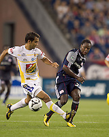 Monarcas Morelia defender Adrian Aldrete (16) fails to stop/block New England Revolution midfielder Joseph Niouky (23) pass. The New England Revolution defeated Monarcas Morelia in SuperLiga 2010 group stage match, 1-0, at Gillette Stadium on July 20, 2010.