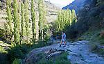 Landscape of the River Rio Poqueira gorge valley, High Alpujarras, Sierra Nevada, Granada Province, Spain woman walking