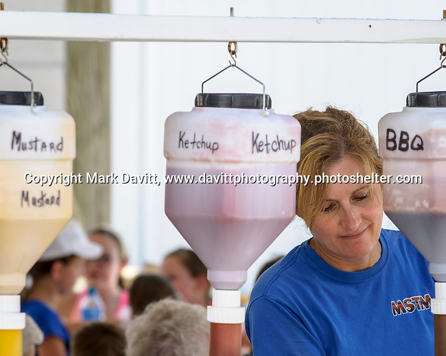 When you need to serve condiments in gallons, it means that you served a lot of sandwiches. Christy Henderson volunteered at the Warren County Pork Producers booth during the Warren County Fair.