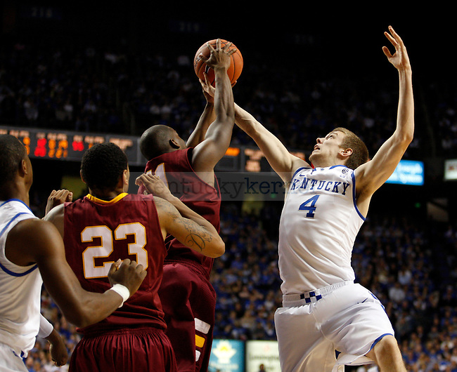 John Hood reaches up for a rebound in the second half of the UK's win over Winthrop Dec. 22, 2010. Photo by Britney McIntosh | Staff