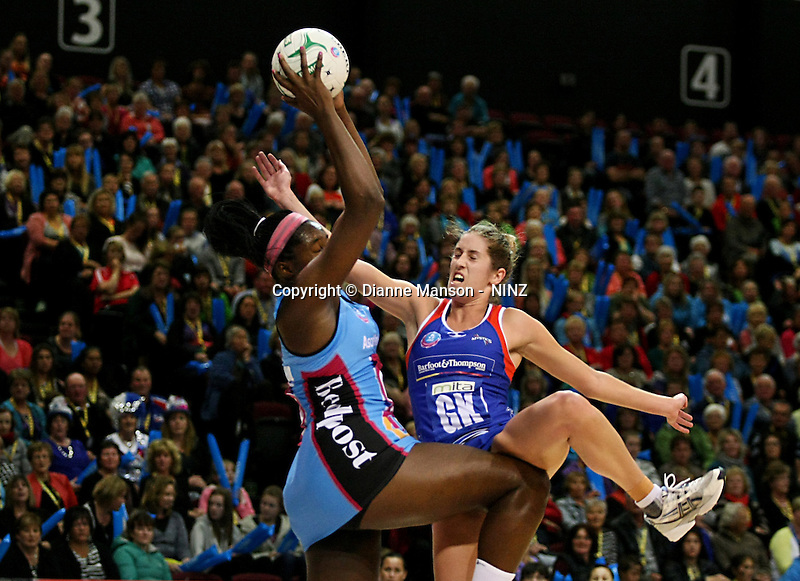 Steel's Jhaniele Fowler - Reid, left, and Jessica Tuki compete for the ball in the ANZ championship netball match, Steel v Mystics, ILT Stadium Southland, Invercargill, New Zealand, Sunday, April 6, 2014. Photo: Dianne Manson
