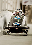 8 January 2016: Justin Kripps, piloting his 2-man bobsled for Canada, enters the Chicane straightaway on his first run, ending the day with a combined 2-run time of 1:51.30 and earning a 4th place finish at the BMW IBSF World Cup Championships at the Olympic Sports Track in Lake Placid, New York, USA. Mandatory Credit: Ed Wolfstein Photo *** RAW (NEF) Image File Available ***