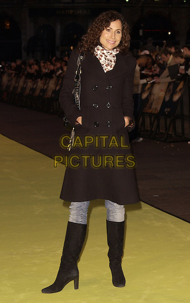 "MINNIE DRIVER.Arrivals at the World Premiere of ""Alien Autopsy"", .Odeon Leicester Square, London, .England, April 3rd 2006..full length black coat scarf knee high boots.Ref: CAN.www.capitalpictures.com.sales@capitalpictures.com.©Can Nguyen/Capital Pictures"