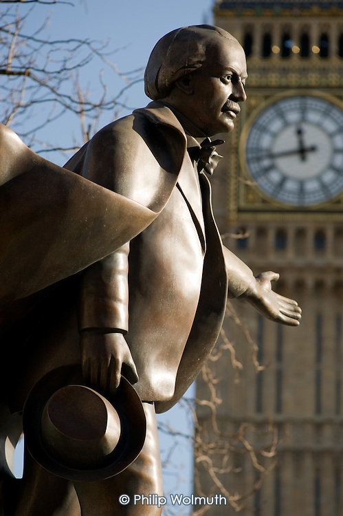 Statue of David Lloyd George in front of Big Ben in Parliament Square, Westminster, London