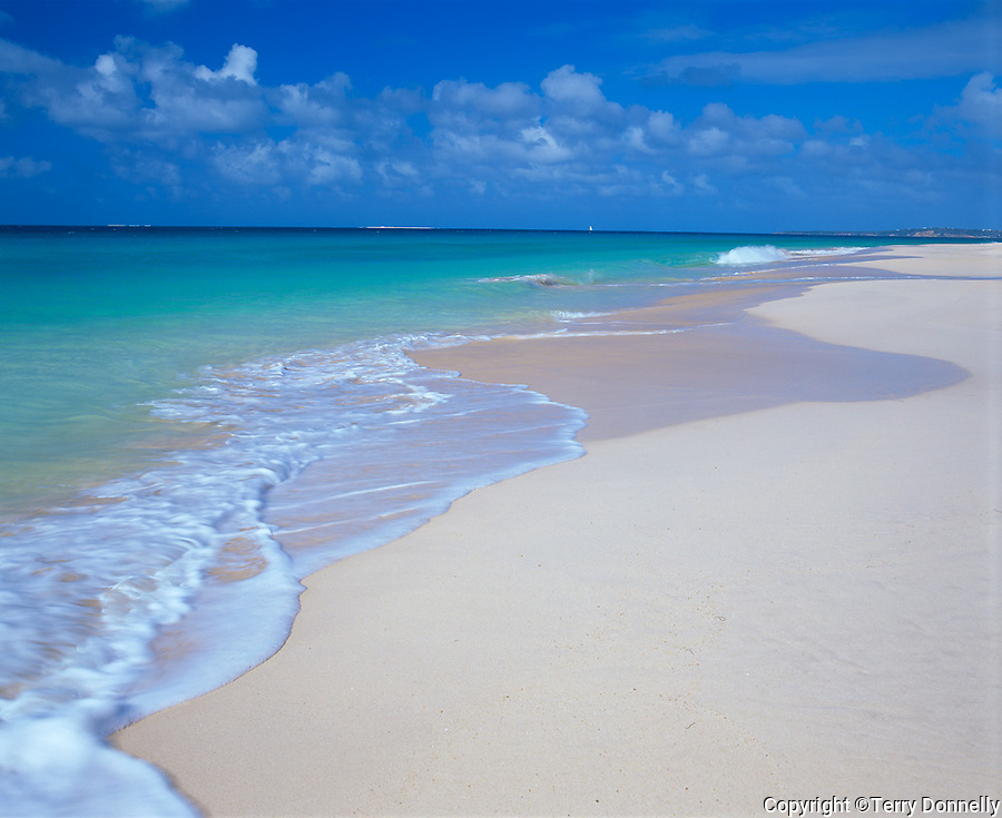 Anguilla, BWI:  Calm surf, wide stretch of white sand beach and turquoise waters of Anguilla's Long Bay, Caribbean Sea