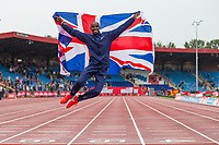 Mo Farah leaps in the air after completing his 3000m race, his last track race ever in the UK during the Muller Grand Prix Birmingham Athletics at Alexandra Stadium, Birmingham, England on 20 August 2017. Photo by Andy Rowland.