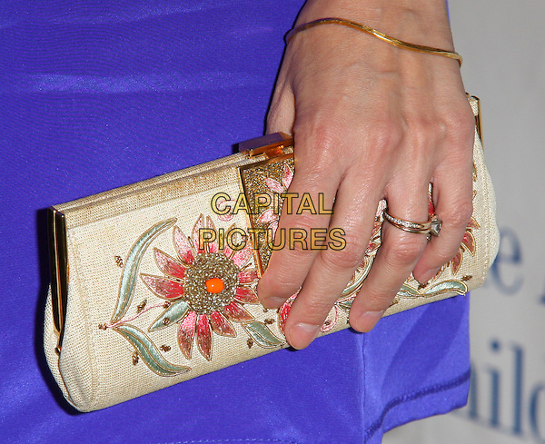 NIA VARDALOS .The Alliance For Children's Rights Annual Dinner Gala held at the Beverly Hilton Hotel, 05 March 2009. .detail hand clutch bag gold embroidered beaded flower ring bracelet .CAP/ADM/KB.©Kevan Brooks/Admedia/Capital PIctures