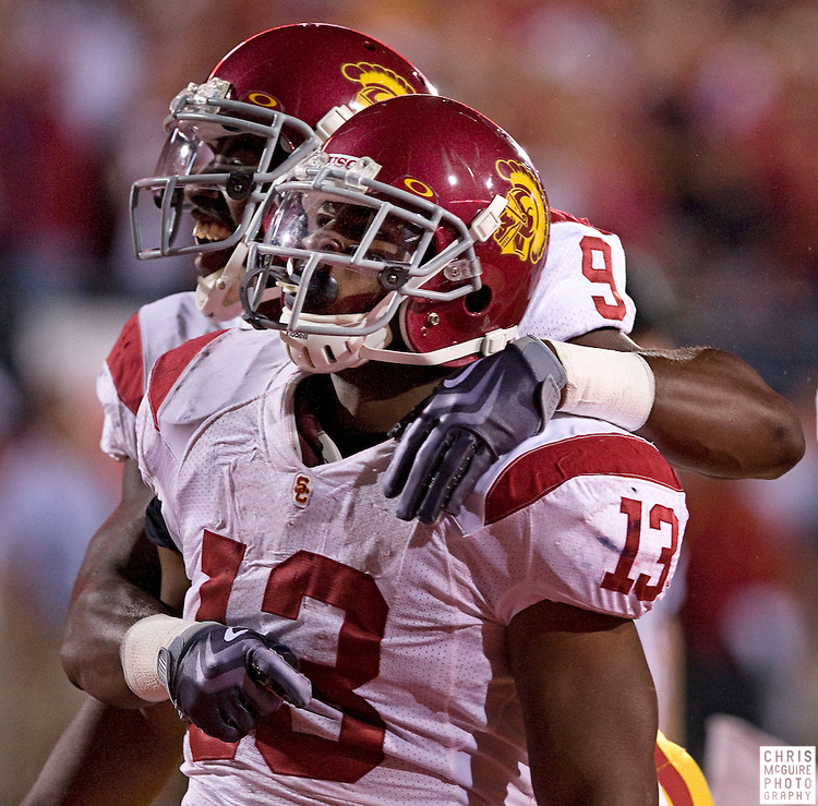 12 September 2009:  Football -- USC running back Stafon Johnson celebrates his first quarter touchdown with wide receiver David Ausberry against Ohio State during their game at Ohio Stadium in Columbus.  USC won 18-15.  Photo by Christopher McGuire.