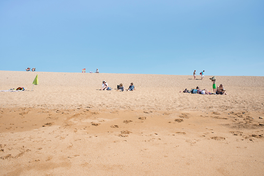 On the beach. Summer day at West Bay, Brid Port, Dorset, UK.