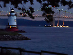 Sleepy Hollow Lighthouse on the Hudson River backed by the Tappan Zee bridge.