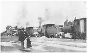 Four locomotives pushing a rotary at Antonito.  Man and two small children observing engines.<br /> D&amp;RGW  Antonito, CO
