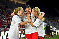 Orlando, FL - Saturday October 14, 2017: Emily Sonnett, Christine Sinclair, Lindsey Horan and the Portland Thorns FC celebrate their National Women's Soccer League (NWSL) Championship win by defeating North Carolina Courage 1-0 during the NWSL Championship match between the North Carolina Courage and the Portland Thorns FC at Orlando City Stadium.