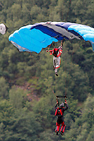 Two parachute jumpers coming in to land near Gudvangen.The Extremesport Week, Ekstremsportveko, is the worlds largest gathering of adrenalin junkies. In the small town of Voss enthusiasts in a varitety of extreme sports come togheter every summer to compete and play.© Fredrik Naumann