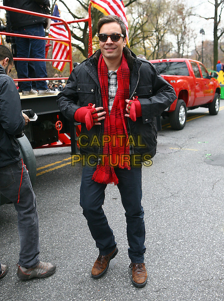 JIMMY FALLON.The 84th Annual Macy's Thanksgiving Day Parade on November 25, 2010 in New York City, NY, USA..November 25th, 2010.full length black jacket sunglasses shades jeans denim red scarf gloves .CAP/ADM/PZ.©Paul Zimmerman/AdMedia/Capital Pictures.