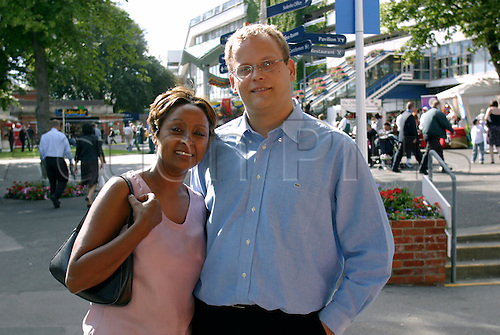 July 27, 2003: Young couple enjoying their first visit to Ascot on Hong Kong Day. Photo: Glyn Kirk/Action Plus...030727 horse racing fashion racegoers racegoer crowd crowds woman