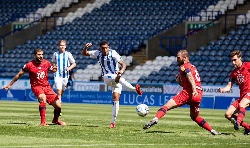 Huddersfield Town's Karlan Grant sees his shot blocked by Wigan Athletic's Danny Fox<br /> <br /> Photographer Alex Dodd/CameraSport<br /> <br /> The EFL Sky Bet Championship - Huddersfield Town v Wigan Athletic - Saturday 20th June 2020 - John Smith's Stadium - Huddersfield <br /> <br /> World Copyright © 2020 CameraSport. All rights reserved. 43 Linden Ave. Countesthorpe. Leicester. England. LE8 5PG - Tel: +44 (0) 116 277 4147 - admin@camerasport.com - www.camerasport.com