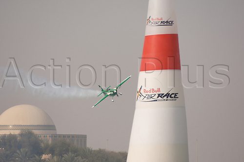 27.03.2010. Abu Dabi. Red Bull Air Race. Plane flies between marker beacons during racing.