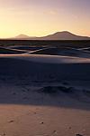 Dusk over sand dunes and ancient volcanoes, San Quintin, Baja California, Mexico