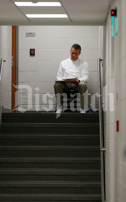 Ohio State Buckeyes head coach Urban Meyer sits by himself outside the locker room before the college football game between the Ohio State Buckeyes and the Michigan State Spartans at Spartan Stadium in East Lansing, Saturday night, November 8, 2014. (The Columbus Dispatch / Eamon Queeney)