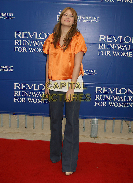MANDY MOORE.14th Annual Entertainment Industry Foundation Revlon Run/Walk For Women held at The Los Angeles Memorial Coliseum, Los Angeles, California, USA,.12 May 2007..full length orange satin white top flared jeans funny.CAP/ADM/RE.©Russ Elliot/AdMedia/Capital Pictures.