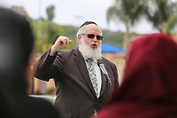 May 3 2019. Carlsbad, CA. | Rabbi Yuruchem Eilfort Sr. of Chabad of La Costa talks at Community Call to Action Led by Community Leaders and Local Elected Officials in Response to Poway Shooting held at Alga Norte Community Park in Carlsbad. | Photos by Jamie Scott Lytle. Copyright.