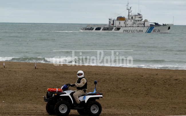 A National Guard drives Bristol Beach while a Coast Guard sails the sea near the spot prepared for the IV America's Summit in Mar del Plata, Argentina, November 1st, 2005..Photographer Diego Giudice/Bloomberg News