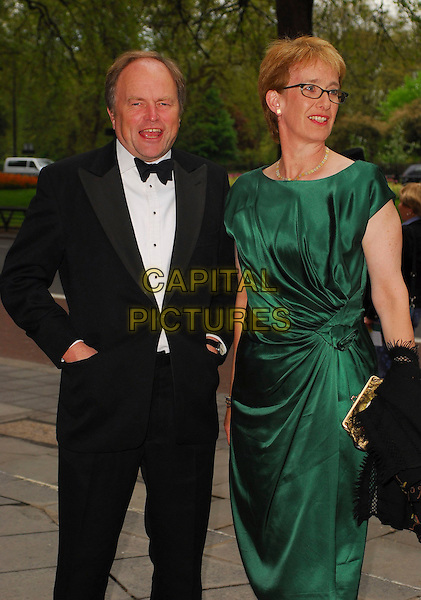 CLIVE ANDERSON & GUEST.Arrivals at the Sony Radio Academy Awards 2006 at Grosvenor House Hotel, London, UK..May 8th, 2006.Ref: CAN.half length black jacket hands in pockets green dress.www.capitalpictures.com.sales@capitalpictures.com.© Capital Pictures.