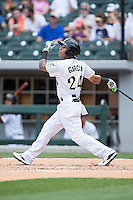 Leury Garcia (24) of the Charlotte Knights follows through on his swing against the Norfolk Tides at BB&T BallPark on June 7, 2015 in Charlotte, North Carolina.  The Tides defeated the Knights 4-1.  (Brian Westerholt/Four Seam Images)