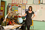 Education Elementary school Grade 4 female teacher with class discussion geography social studies horizontal