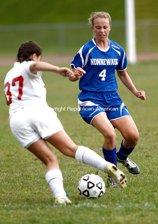 Winsted, CT- 16 September 2013-091613CM12- Nonnewaug's Jennifer Wingard, right, defends, as Northwestern's Morgan Gillette brings the ball up field during Berkshire League soccer action in Winsted Monday afternoon.    Christopher Massa Republican-American