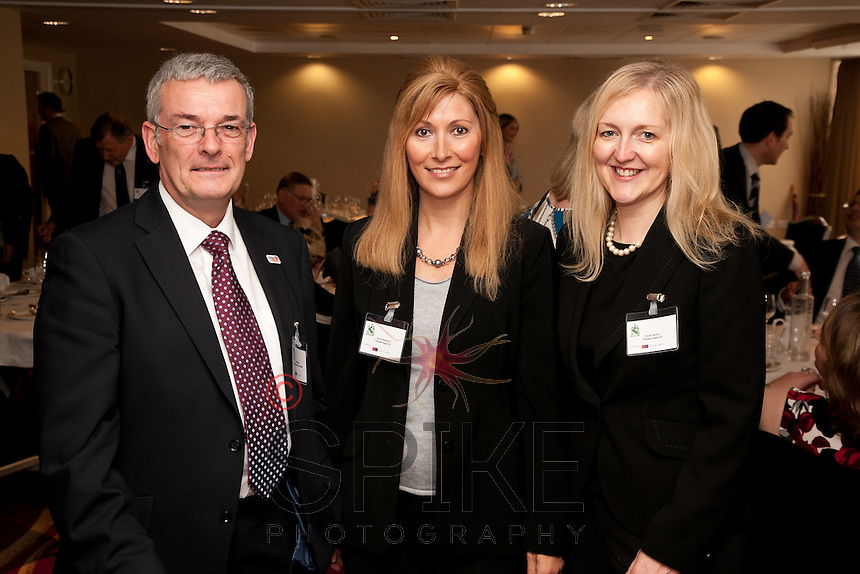 Pictured from left are Mike Butler of Thompson Butler Associates and Sarah Robinson and Karen Murrin of Premier Legal