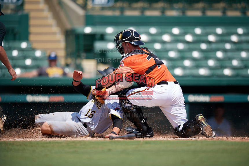 Baltimore Orioles catcher Ben Breazeale (79) tags Mason Martin (16) sliding into home during an Instructional League game against the Pittsburgh Pirates on September 27, 2017 at Ed Smith Stadium in Sarasota, Florida.  (Mike Janes/Four Seam Images)