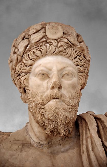 Roman sculpture of the Emperor Marcus Aurelius, excavated from Bulla Regia Theatre, sculpted circa late second century. The Bardo National Museum, Tunis. Against a grey art background.