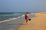 Woman walking barefoot on sandy beach Nilavelli beach , near Trincomalee, Eastern province, Sri Lanka, Asia