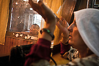 A kashmiri muslim women claim as they pray at the Dasrgir Saheb shrine in Srinagar. Muslims around the world are attending the holy month of Ramadan, where they observe the devout fast from dawn to dusk.