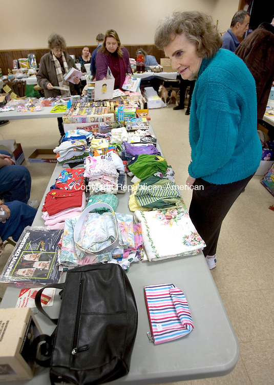 BETHLEHEM CT. 05 April 2014-040514SV09-Shirley Petrillo of Watertown shops around at an indoor flea market sponsored by the Bethlehem Grange at Memorial Hall in Bethlehem Saturday. Proceeds from the event go toward the support of Grange community service projects.<br /> Steven Valenti Republican-American