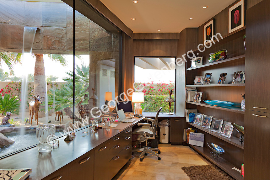 Beautiful home office shows views of outside water feature