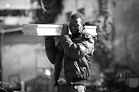 Ebrima, President and Hard Worker.<br /> <br /> Rome, 01/05/2019. This year I will not go to a MayDay Parade, I will not photograph Red flags, trade unionists, activists, thousands of members of the public marching, celebrating, chanting, fighting, marking the International Worker's Day. This year, I decided to show some of the Workers I had the chance to meet and document while at Work. This Story is dedicated to all the people who work, to all the People who are struggling to find a job, to the underpaid, to the exploited, and to the people who work in slave conditions, another way is really possible, and it is not the usual meaningless slogan: MAKE MAYDAY EVERYDAY!<br /> <br /> Happy International Workers Day, long live MayDay!