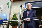 The President of Glen Dimplex, Martin Naughton, cuts the tape to officially  open the new school extension at Scoil Bhride Dunleer. Photo:  Andy Spearman.