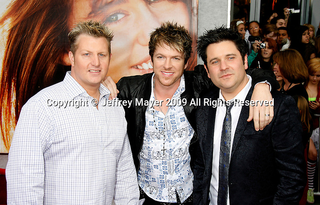 """HOLLYWOOD, CA. - April 02: Rascal Flatts' Gary LeVox, Joe Don Rooney and Jay DeMarcus arrive at the premiere of Walt Disney Picture's """"Hannah Montana: The Movie"""" held at the El Captian Theatre on April 2, 2009 in Hollywood, California."""