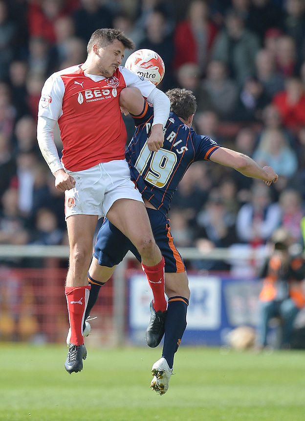 Fleetwood Town's Bobby Grant out jumps Blackpool's David Norris<br /> <br /> Photographer Dave Howarth/CameraSport<br /> <br /> Football - The Football League Sky Bet League One - Fleetwood Town v Blackpool - Saturday 23rd April 2016 - Highbury Stadium - Fleetwood  <br /> <br /> &copy; CameraSport - 43 Linden Ave. Countesthorpe. Leicester. England. LE8 5PG - Tel: +44 (0) 116 277 4147 - admin@camerasport.com - www.camerasport.com