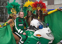 Germany, DEU, Dortmund, 2006-Jun-22: FIFA football world cup (USA: soccer world cup) 2006 in Germany; a Brazilian samba group posing with a German policeman sitting on a motorbike.